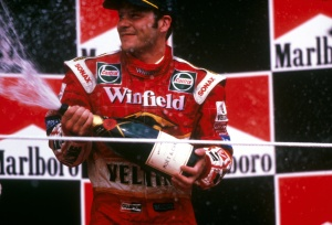 Jacques Villeneuve (CDN) celebrates his third place finish on the podium. Hungarian Grand Prix, Budapest, 16 August 1998.